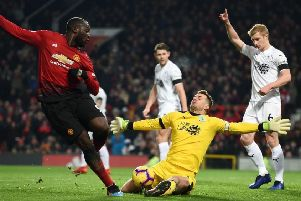 Burnley's English goalkeeper Tom Heaton (C) saves a shot from Manchester United's Belgian striker Romelu Lukaku (L) during the English Premier League football match between Manchester United and Burnley at Old Trafford in Manchester, north west England, on January 29, 2019. (Photo by Paul ELLIS / AFP) / RESTRICTED TO EDITORIAL USE. No use with unauthorized audio, video, data, fixture lists, club/league logos or 'live' services. Online in-match use limited to 120 images. An additional 40 images may be used in extra time. No video emulation. Social media in-match use limited to 120 images. An additional 40 images may be used in extra time. No use in betting publications, games or single club/league/player publications. /         (Photo credit should read PAUL ELLIS/AFP/Getty Images)