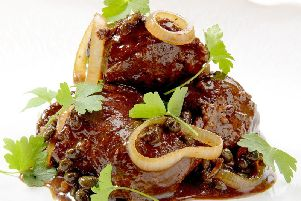Braised pig cheeks, with capers and parsley