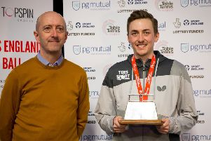 Liam Pitchford collects his trophy from Mike Perry, CEO of PG Mutual. Pic by Alan Man.