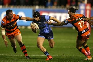 Jonny Lomax evades the Castleford Tigers defence) during their 42-12 win at the Mend-A-Hose Jungle