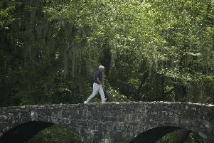Crossing the bridge to success?: Tiger Woods goes over the Nelson Bridge on the 13th hole.