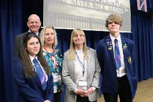 Margaret Aspinall (centre), Sue Roberts and John Pout are flanked by head girl Livvy Sergision and head boy Ethan Watts