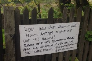 Concerned residents have erected handmade signs to highlight a planning application for 119 new homes on the Oakwell Brickworks beauty spot in Little Hallam.