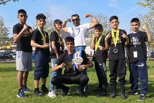 Rizwan Aslam shows of his MTK Box Cup belt to his Purge gym mates after he fought with a broken thumb to secure victory.