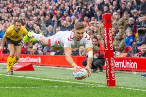 Tommy Makinson scores for England against New Zealand at Anfield. Picture: SWPix