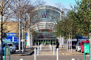 A man has been arrested after a police chase through the White Rose Centre in Leeds.