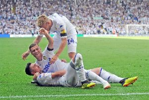 PERFECT START: Pablo Hernandez celebrates Leeds United's second goal against Stoke on the opening day of last season with team-mates Samuel Saiz and Liam Cooper. Picture: Tony Johnson..