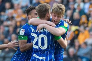 Joe Gelhardt is mobbed after his goal at Hull
