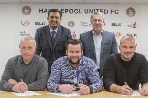 Ged McNamee, Matthew Bates and Ross Turnbull sign up at Hartlepool United watched by Raj Singh and Craig Hignett