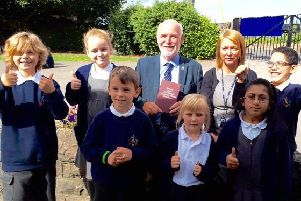 Grant: Cllr Eric Firth gives the good news to Hanging Heaton headteacher Janet Potter and pupils.