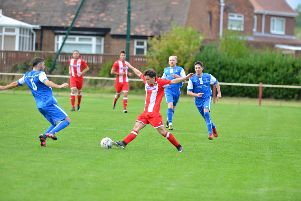 Ryhope CW's  Shaun Pickford (red and white) attempts to evade a Dunston UTS tackle