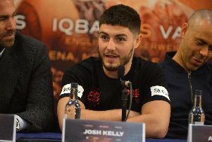 Josh Kelly is flanked by trainer Adam Booth (right) and promoter Eddie Hearn (left).