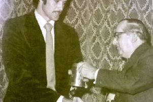 Peter Willey receiving an award from the then president Tot Lonsdale. Peter joined Harbour as an 8 year old.