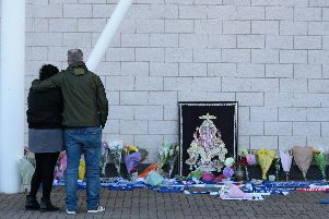 People pay tribute at Leicester City Football Club after a helicopter used by club owner Vichai Srivaddhanaprabha, crashed into flames in a car park near the stadium shortly after 8.30pm on Saturday. Picture Aaron Chown/PA Wire