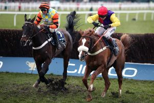 Native River (right) wins the Timico Cheltenham Gold Cup Chase ahead of Might Bite - the pair are set to clash again at Haydock on Saturday