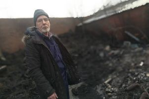 Paul Patzer with some of the damage caused after a blaze ripped through the yard of his garage in Boldon