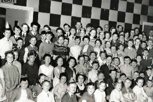 They were all ready to watch Uncle Bill in the 1950s.  Can anyone recognise themselves in the shot and what was the venue?