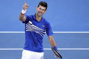 Serbia's Novak Djokovic celebrates after defeating France's Lucas Pouille in their semifinal at the Australian Open. (AP Photo/Kin Cheung)