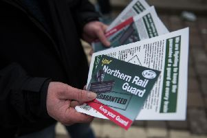 Members of rail staff taking industrial action hand out leaflets (Pic: OLI SCARFF/AFP/Getty Images)