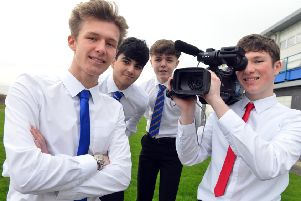 Whitburn Academy students produced a running video to beat the Metro. From left Jamie Barnshaw, Mohammod Moghtaderi, Finlay Munday and Patrick Allen.