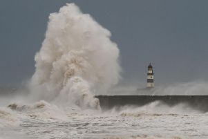 Waves crash over the North Pier at Seaham earlier today.