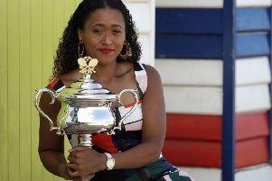 Japan's Naomi Osaka holds her the Daphne Akhurst Memorial Cup at Melbourne's Brighton Beach following her win over Petra Kvitova at the Australian Open (Picture: Aaron Favila/AP).