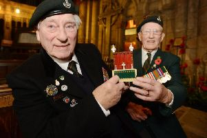 Charles Eagles, left, and Dicky Atkinson, from the Durham Light Infantry Association, visit Durham Cathedral to help build a Lego replica in 2014.