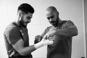 Josh Kelly (left) with trainer Adam Booth (right). Picture via Matchroom Boxing.