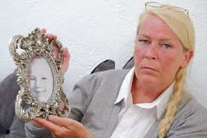 Sharon Henderson with a picture of her murdered daughter Nikki Allan.