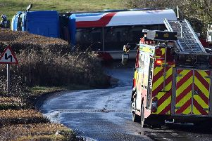 Emergency services at the overturned tanker. Picture by Steve Miller