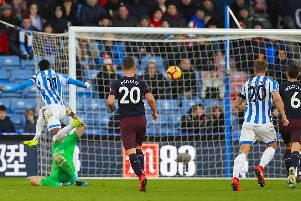 Whose goal?: Arsenal's Sead Kolasinac is credited with an own goal but Huddersfield's Karlan Grant claims he got the last touch.