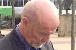 Gary Henderson, 57, leaves Teesside Crown Court where he was given a suspended sentence on Wednesday after admitting conducting independent research while sitting as a juror during a trial at the same court in November 2017.