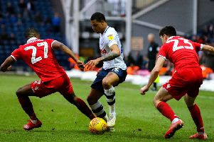 PNE's Lukas Nmecha takes on Nottingham Forest's Tendayi Darikwa and Joe Lolley