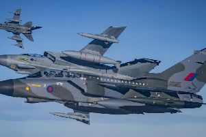 Ministry of Defence handout photo of three specially painted Tornado GR4's flying a unique photographic sortie as part of the Tornado Force farewell to the GR4 on Wednesday. Picture by Cpl Lee Matthews RAF