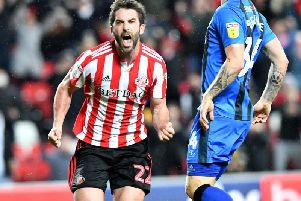 Will Grigg celebrates his first goal for Sunderland.