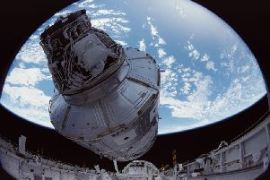 IMAX images from December 1998, show the crew of Space Shuttle Mission STS-88 beginning construction of the International Space Station