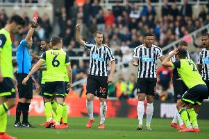 Huddersfield Town's Tommy Smith (far right) is shown a red card.