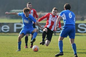 Wearside League Shipowners Cup football between Sunderland West End (red/white) and Richmond Town, played at Nissan Sports Complex, Washington.