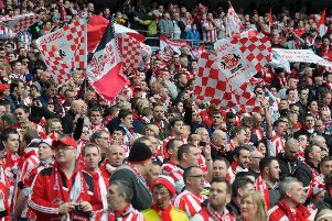 Fans inside the ground.