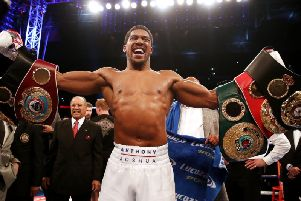 Anthony Joshua proudly presents his world championship belts to the crowd after his last win over Alexander Povetkin.