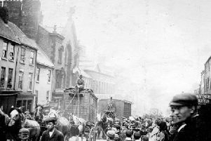 Huge crowds watched the circus as it passed through High Street East.
