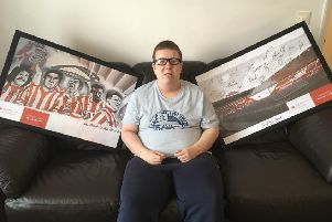 Blind phtotographer, Alex Ditch, with the signed Sunderland AFC photos he is raffling for charity.