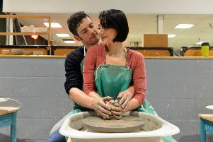 Ghost the Musical cast Molly played by Rebekah Lowings and Sam played by Niall Sheehy re-create the iconic pottery scene at the National Glass Centre