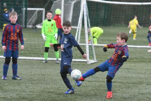 Wrekenton Nou Camp Oranges under 8s, in red and blue, take on Washington AFC Tigers under 8s, in dark blue.