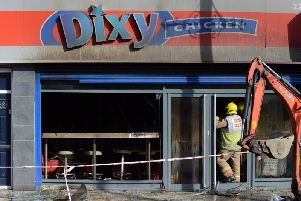 An investigation into the cause of the fire at Dixy Chicken continues today