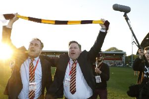 STICKING AROUND: Stefan Rupp, right, pictured with former co-owner Edin Rahic when celebrating at Fleetwood after reaching the League One playoff final. Picture: Martin Rickett/PA Wire.