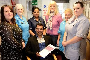 Bijumon Joseph manager of Marigold Nursing Home with their Outstanding Certificate and staff members (left to right) Joanne Fielden, Lynn Davison, Noby Biju, Yvonne Ivey, Doreen Hardy and Diane Mason. Picture by FRANK REID