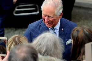 HRH Prince Charles greets people outside The Old Courts in Wigan