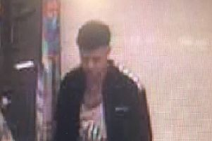 CCTV image of a man police want to speak to following the theft of a television from Asda at the Galleries in Washington.