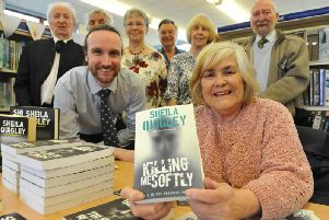 Author Sheila Quigley with trustees of Whitburn Library.